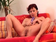 Mature Redhead Plays With Fake penis